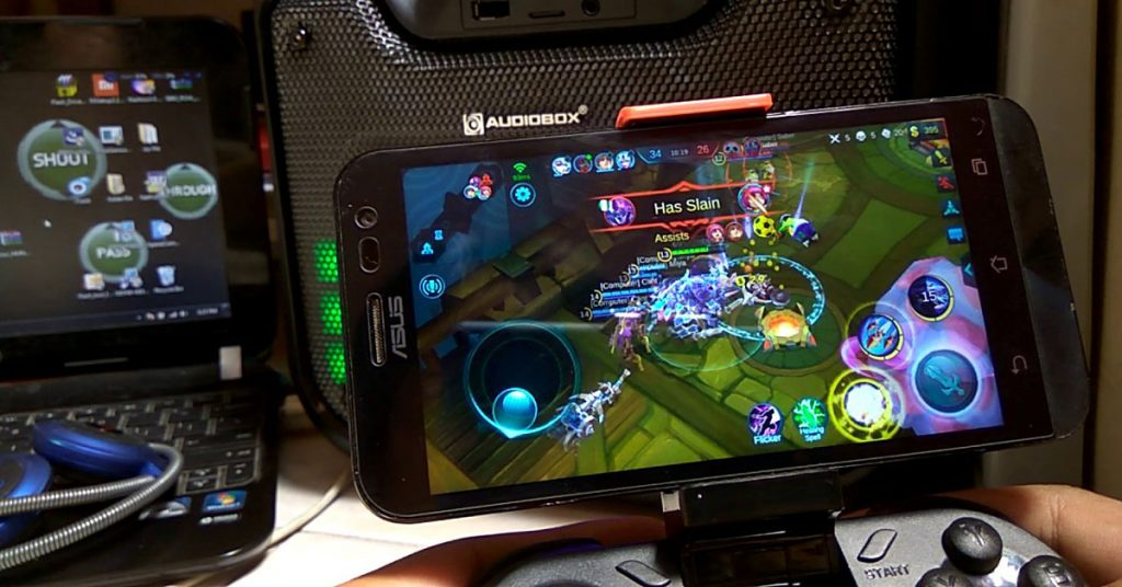 Mobile Legends dengan aksesori gamepad